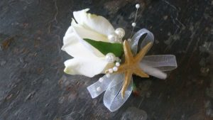 Rose corsage, boutonniere with starfish