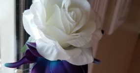 Rose and galaxy orchid boutonniere